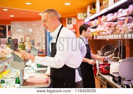 Shopkeepers working in their grocery store