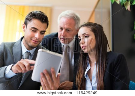 Business people working on a tablet