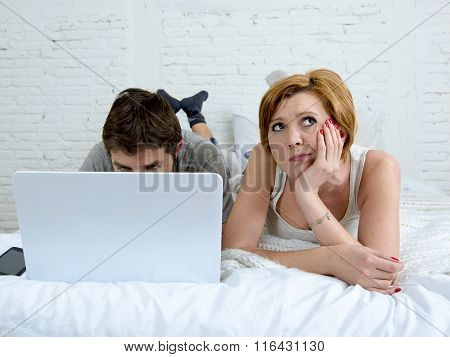 Attractive Woman Feeling Upset Unsatisfied And Frustrated In Bed With His Husband While The Man Work