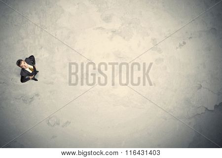 Business man from top standing with copy space desert background