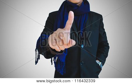 Businessman in casual suit pointing on empty space, selective focus on hand