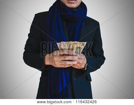 Businessman in winter suit holding or counting cash