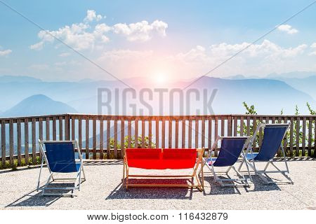 Sunset Above The Sunbeds In Mountains