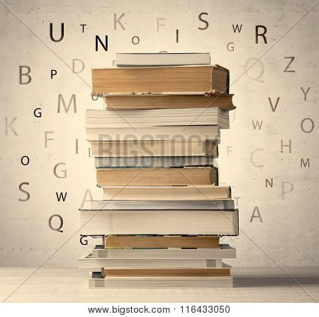 Books with flying letters on vintage old background
