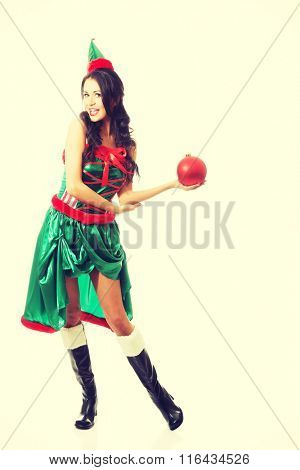 Full length woman holding christmas bubble on the left hand