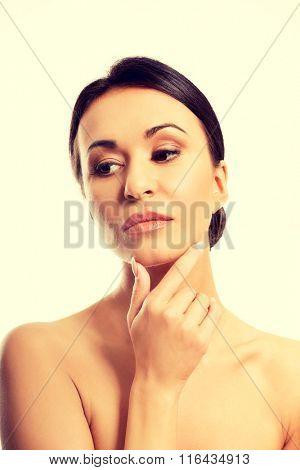 Thoughtful topless woman touching chin