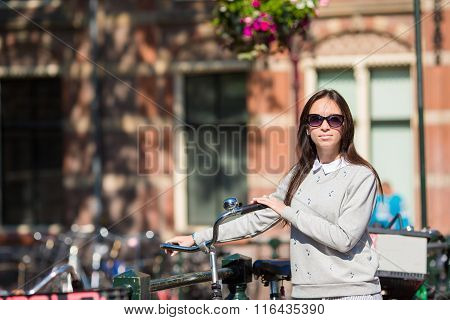 Young woman with bike on european vacation at Amsterdam