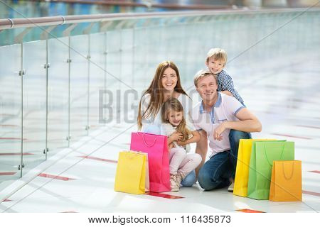 Happy families with a children in a store