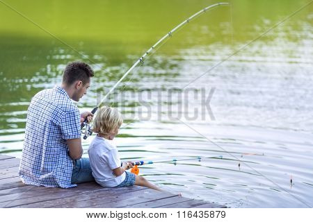 Father and son fishing outdoors