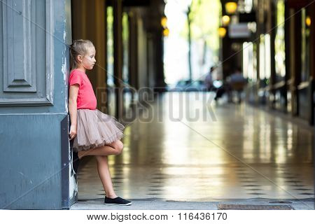 Adorable little girl at european city outdoors