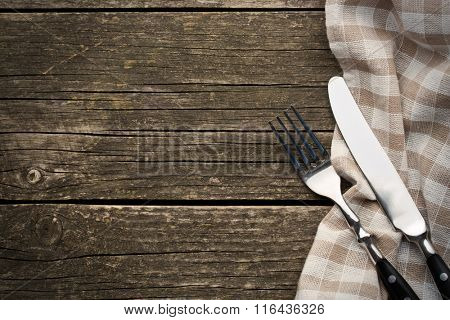 the fork and knife on old wooden table
