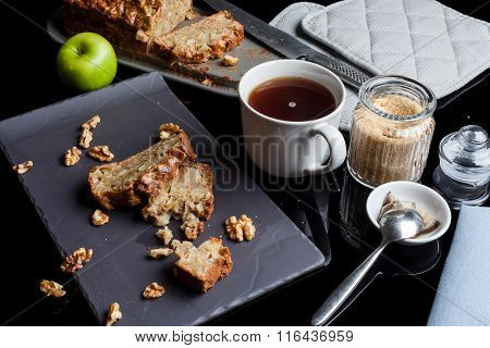 Pieces of apple cake and tea from high angle