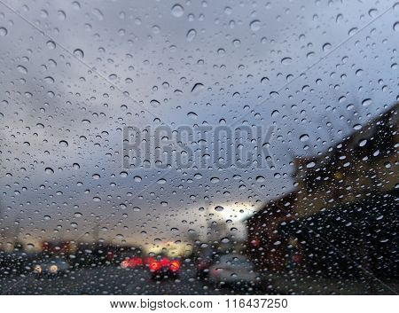 Driving In The Rain With Many Water Drops In The Glass