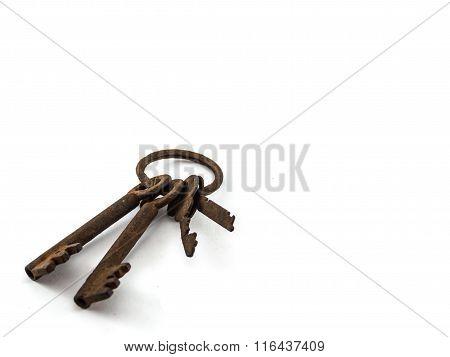 Old Rusty Key On White Background.