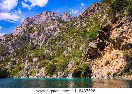 Stony slopes of canyon go down in azure rivers Verdon