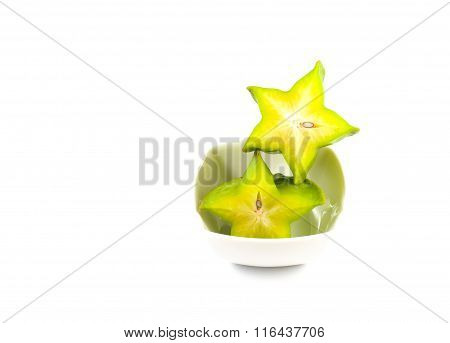 Green And Yellow Color Of Starfruit On White Background