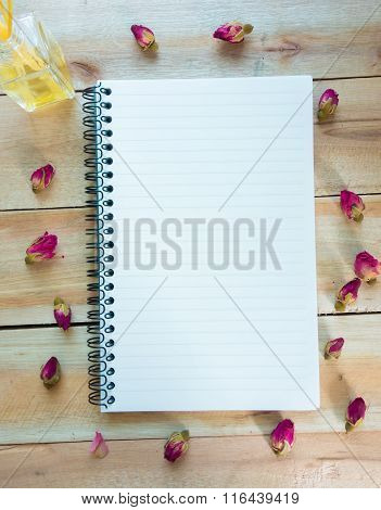 Blank Notebook With Copy Space And Rose , Perfume Put On The Wood Floor, Digital Effect Vintage Styl