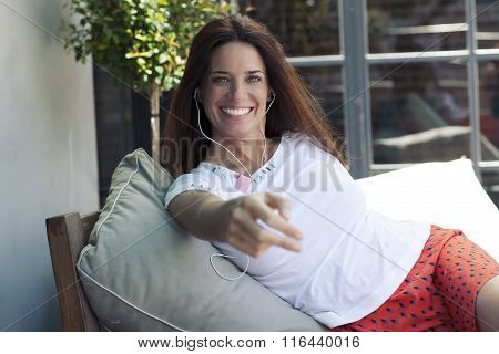 Happy adult latin woman smiling with pods