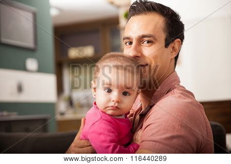 Father And Baby Daughter Relaxing At Home