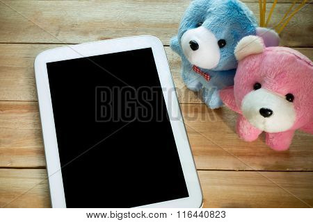 The Tablet With Couple Teddy Put On The Wood Floor, Digital Effect Vintage Style