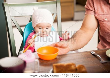 Cute Baby Girl Eating Soft Food At Home
