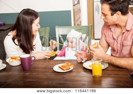 Parents Feeding Their Baby At Home