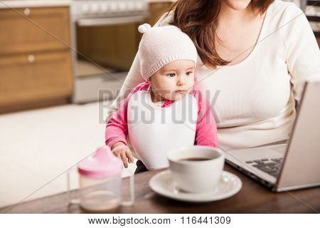 Cute Baby Girl Working With Her Mom
