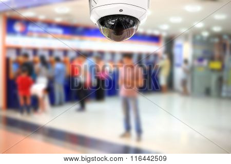 People Withdraw Money Automatic Teller Machine With Cctv Camera.