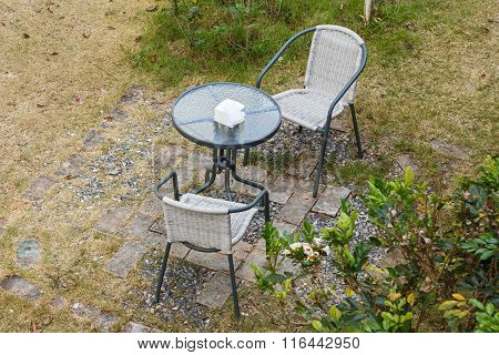 Modern Table And Chairs In Garden