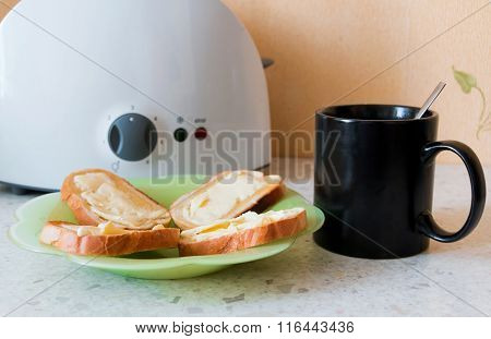 Toast With Butter On A Glass Plate And A Mug Of Tea
