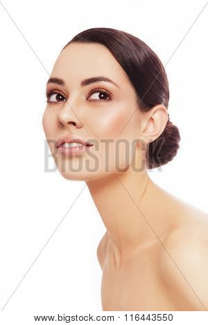 Portrait of young beautiful healthy happy woman looking upwards, over white background