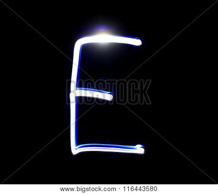 E Easy Alphabet Hand Writing Blue Light  Over Black Background.
