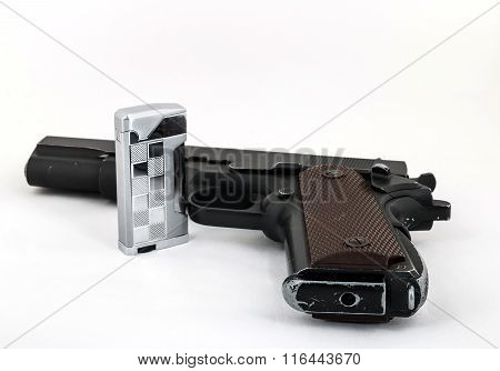 Gun And A Lighter On A Light Background