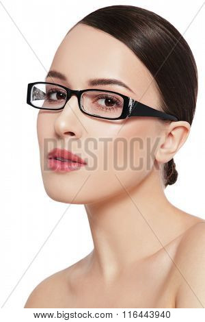 Portrait of young beautiful healthy woman in glasses over white background