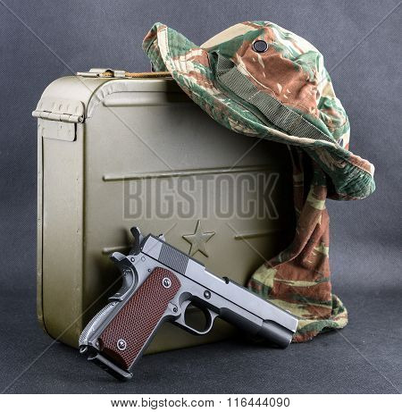 Box For Bullets, A Gun And A Camouflaged Hat.