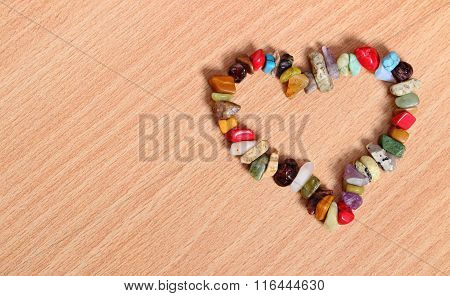 Heart Shaped Colorful Bracelet On Wooden Background