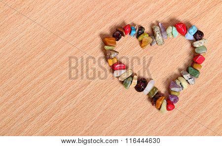 Heart Shaped Colorful Bracelet On Wooden Background