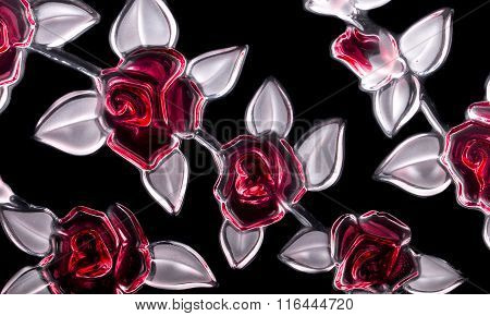 The Pattern Of The Glass Flowers On A Black Background. Isolated.