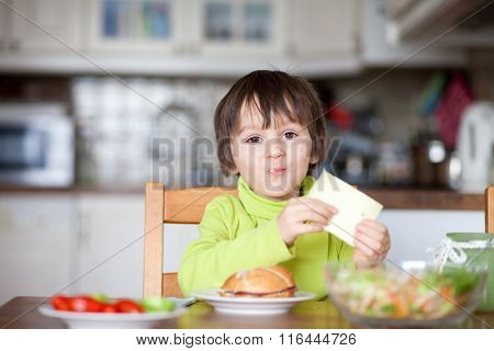 Beautiful Little Boy, Eating Sandwich At Home