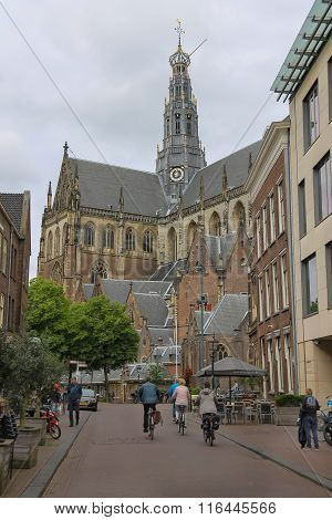 People Near The Grote Kerk (sint-bavokerk) In The Historic Center Of Haarlem, The Netherlands