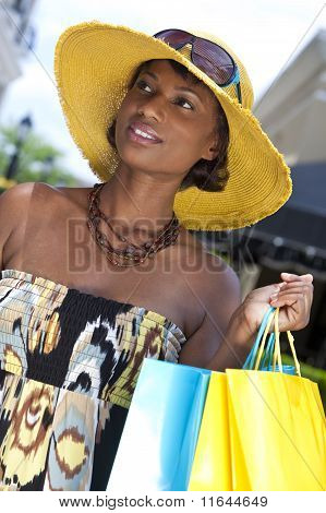 Beautiful African American Woman With Fashion Shopping Bags