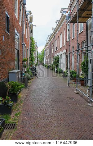 Narrow Street In The  Historic Center Of Haarlem, The Netherlands