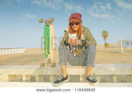skater girl with smartphone
