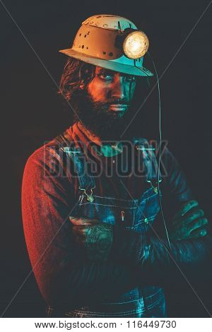 Portrait Of Bearded Miner Wearing Helmet Lamp