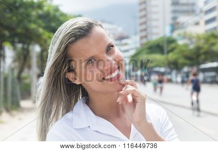 Happy Woman With Blonde Hair In The City
