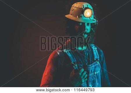 Miner Wearing Helmet Lamp Smoking Cigarette