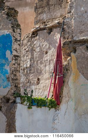 Demolished House And A Moroccan Flag