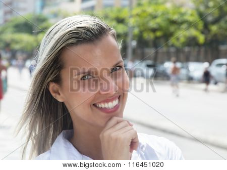 Laughing Woman With Blonde Hair In The City
