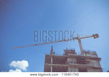 Construction Site With Crane Working On Vintage Color Tone