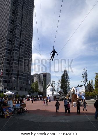 Person Ziplines Through Justin Herman Plaza
